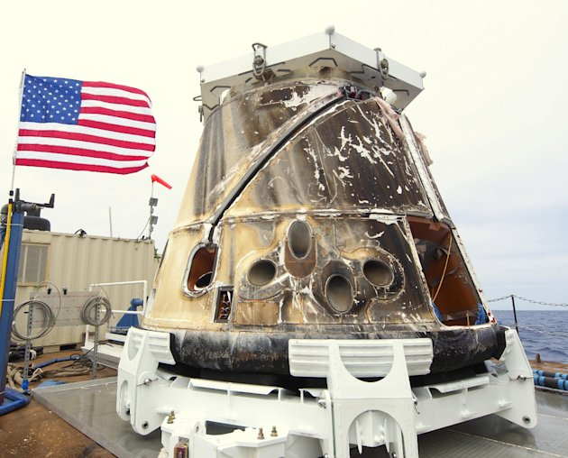 This photo provided by SpaceX shows the Dragon spacecraft on a boat in the Pacific Ocean on Thursday, May 31, 2012. Triumphant from start to finish, the Dragon parachuted into the Pacific on Thursday 