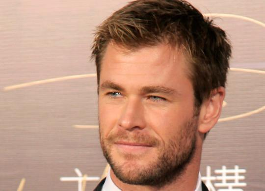 Chris Hemsworth Looks Hungry in a Behind-the-Scenes Photo From'In the Heart of the Sea'