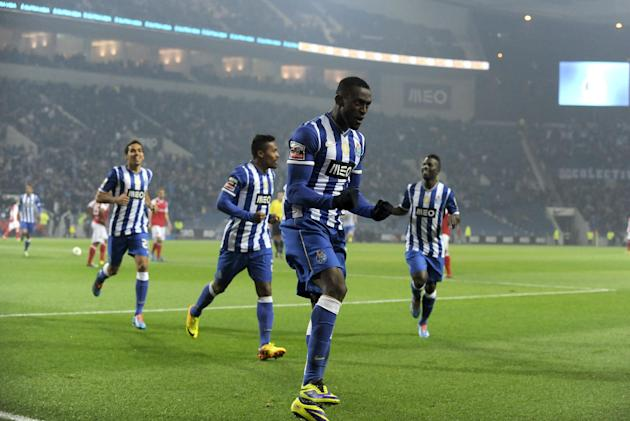 FC Porto's Jackson Martinez, from Colombia, celebrates with teammates after scoring the opening goal against Sporting Braga in a Portuguese League soccer match at the Dragao Stadium in Porto, Port
