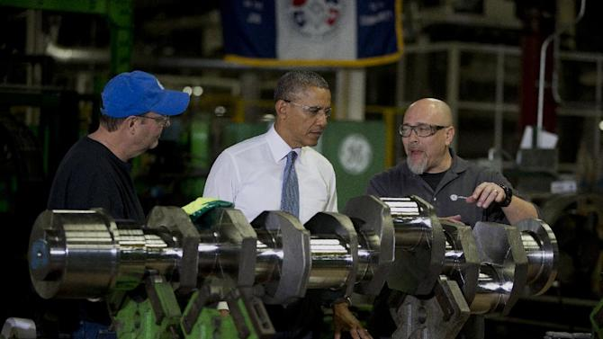 President Barack Obama looks at a crank shaft as he tours General Electric's Waukesha Gas Engines facility, Thursday, Jan. 30, 2014, in Waukesha, Wis. as part of a four-stop tour he is making to expand on themes from his State of the Union address. (AP Photo)