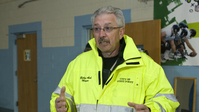 Billy Ash, Mayor of West Point updates residents of West Point, Ky., living within a mile-and-a-half radius of the site of a train derailment as they wait at a Red Cross shelter Wednesday, Oct. 31, 2012 at the Muldraugh Elementary School in Muldraugh, Ky. A Paducah & Louisville Railway train carrying hazardous chemicals derailed just after 6 a.m. EDT Monday, A leak of a potentially explosive material was contained, but authorities say three workers were severely burned in a fire that erupted while contractors were removing debris from the train today in southwest Louisville, Kentucky. (AP Photo/Brian Bohannon)