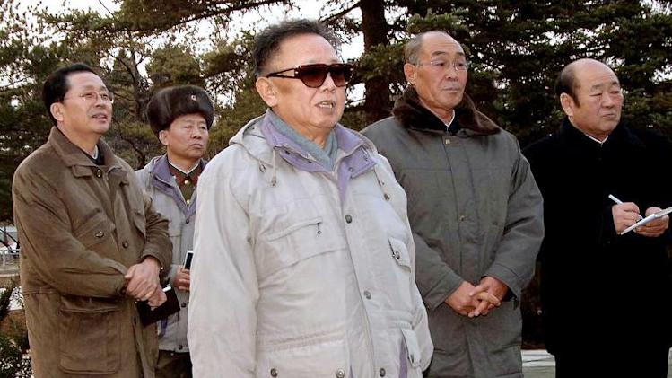 Picture released by the Korean Central News Agency on December 2, 2008 shows then-North Korean leader Kim Jong-Il (C) inspecting Pyongyang's central zoo as his brother-in-law Jang Song-Thaek (back L) looks on