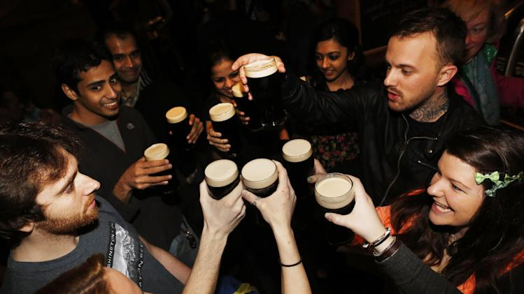 IMAGE DISTRIBUTED FOR DIAGEO - Patrons enjoy pints of Guinness Stout as New Yorkers celebrate St. Patrick's Day one day early at Puck Fair, Saturday, March 16, 2013, in New York. (John Minchillo/AP Images for Diageo)