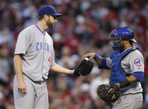 Votto, Hanigan HRs lead Reds over Cubs 7-4