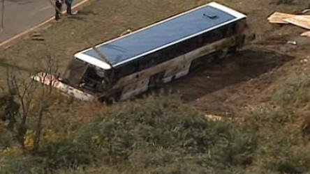 Tour bus overturns