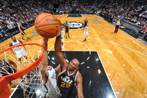 BROOKLYN, NY - DECEMBER 18: Al Jefferson #25 of the Utah Jazz goes to the basket against Brook Lopez #11 of the Brooklyn Nets during the game at the Barclays Center on December 18, 2012 in Brooklyn, New York. (Photo by Jesse D. Garrabrant/NBAE via Getty Images)