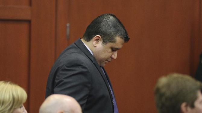"""In this Saturday, July 13, 2013 photo George Zimmerman stands during a break in his second degree murder trial in the killing of Trayvon Martin in Sanford, Fla. Whether they think he got away with murdering 17-year-old Trayvon Martin or that he was just a brave neighborhood watch volunteer """"standing his ground,"""" many Americans can't seem to get enough of George Zimmerman. And he can't seem to stop giving it to them. (AP Photo/Orlando Sentinel, Joe Burbank, Pool)"""