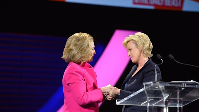 "This image released by Women in the World shows former Secretary of State Hillary Rodham Clinton, left, being greeted by Tina Brown, Editor in Chief, Newsweek & The Daily Beast at the Women in the World Conference on Friday, April 5, 2013 in New York. Clinton said Friday that the rights of women represent ""the unfinished business of the 21st century"" in the United States and around the world, receiving a rapturous reception for one of her first speeches since departing the Obama administration.  (AP Photo/Women in the World, Marc Bryan-Brown)"