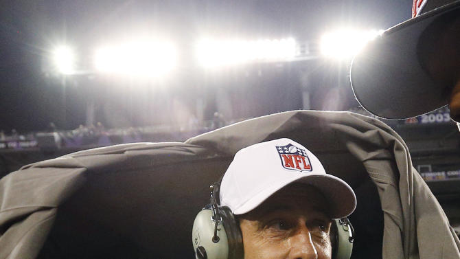 Referee Gene Steratore talks to booth officials before an NFL football game between the Baltimore Ravens and Cleveland Browns in Baltimore, Thursday, Sept. 27, 2012. (AP Photo/Patrick Semansky)