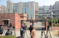 "<p>Indian media wait outside the district court Saket in New Delhi on January 5, 2013. The father of the New Delhi gang-rape victim has revealed his daughter's identity to a British newspaper and called for her name to be made public ""to give courage to other women"" in an interview published Sunday.</p>"
