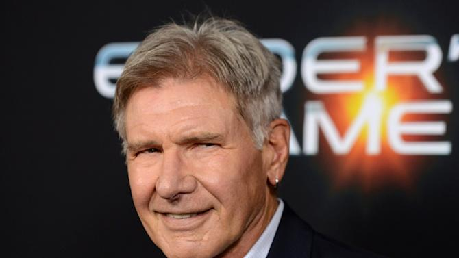 """FILE - This Oct. 28, 2013 file photo shows actor Harrison Ford at the LA Premiere of """"Ender's Game"""" in Los Angeles. Ford is recuperating after surgery to heal a broken leg suffered during production on """"Star Wars: Episode VII."""" The actor's publicist said that Ford is doing well after surgery and will soon begin rehab. Ford was injured a week ago during filming of the much-anticipated sequel at Pinewood Studios outside of London. The accident involved a spacecraft door falling on the 71-year-old actor's leg. Ford's Han Solo pilots the Millennium Falcon, which is returning in """"Episode VII.""""(Photo by Jordan Strauss/Invision/AP, File)"""