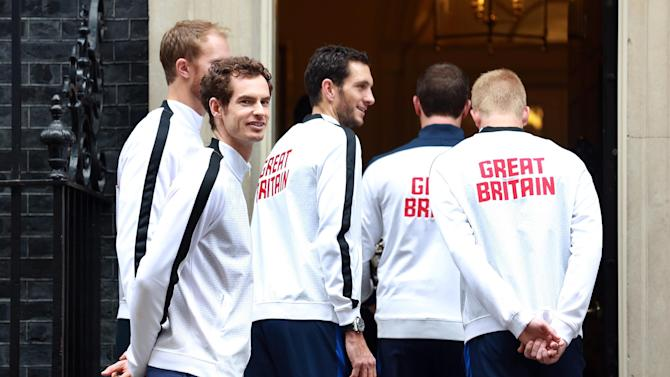 Great Britain's Andy Murray with James Ward and members of the Davis Cup Team as they enter 10 Downing Street