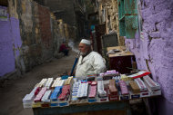 An Egyptian tobacco vendor waits for customers in the al-Azhar quarter in Cairo, Egypt, Thursday, Dec. 1, 2011. The fundamentalist Brotherhood is emerging as the biggest winner in partial results from the first voting this week in Egypt's landmark election, in which voters turned out in unexpected droves. (AP Photo/Bernat Armangue)