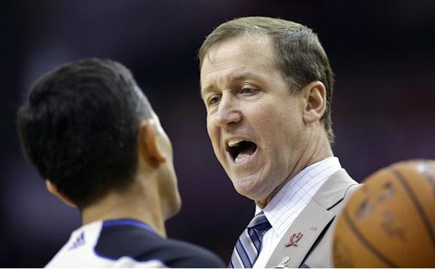 Portland Trail Blazers coach Terry Stotts, right, talks with official Zach Zarba, left, during a timeout in the second quarter of an NBA basketball game against the Houston Rockets, Sunday, March 9, 2