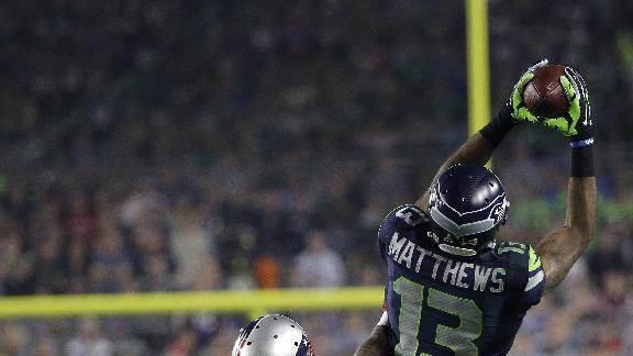 Seattle Seahawks wide receiver Chris Matthews (13) catches a pass in front of New England Patriots cornerback Kyle Arrington (25) during the second half of NFL Super Bowl XLIX football game Sunday, Feb. 1, 2015, in Glendale, Ariz