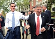 Republican presidential hopeful Mitt Romney greets former New Hampshire governor John Sununu (R) outside the New Hampshire Statehouse in October 2011. Sununu sneered that he wished Obama &quot;would learn how to be an American&quot; -- a comment that recalled previous attacks on the black president&#39;s identity and background