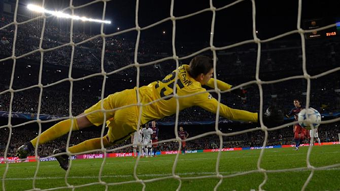 Roma's goalkeeper Wojciech Szczesny clears the ball on a penalty kick by Barcelona's Neymar during their UEFA Champions League Group E match, at the Camp Nou stadium in Barcelona, on November 24, 2015