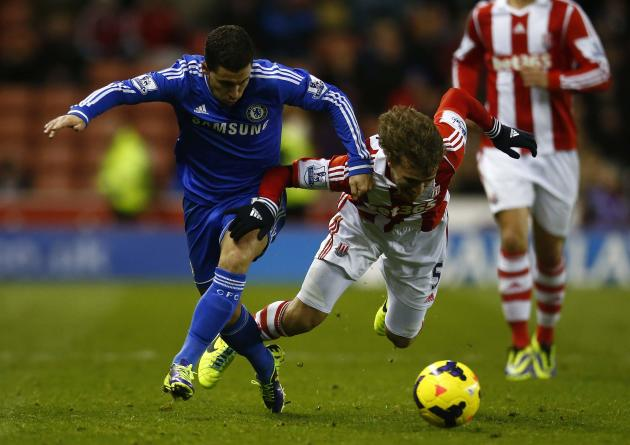 Chelsea's Eden Hazard moves past Stoke City's Marc Muniesa during their English Premier League soccer match at the Britannia Stadium in Stoke-on-Trent, central England