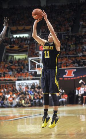 Michigan takes title with 84-53 win at Illinois