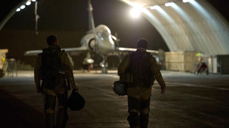 This picture released by the French Army Communications Audiovisual office (ECPAD) shows French fighter pilots walking toward their Mirage 2000 D, at Kossei camp in N'Djamena, Chad, Friday, Jan. 11, 2013. The battle to retake Mali's north from the al-Qaida-linked groups controlling it began in earnest Saturday, after hundreds of French forces deployed to the country and began aerial bombardments to drive back the Islamic extremists from a town seized earlier this week. (AP Photo/ R.Nicolas-Nelson, Ecpad)