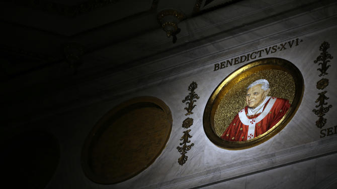 The icon of Pope Benedict XVI is lit inside St. Paul Outside the Walls Basilica, in Rome,Tuesday, Feb.12, 2013.  With a few words in Latin, Pope Benedict XVI did what no pope has done in more than half a millennium, stunning the world by announcing his resignation Monday, Feb. 11, 2013, and leaving the already troubled Catholic Church to replace the leader of its 1 billion followers by Easter. (AP Photo/Gregorio Borgia)