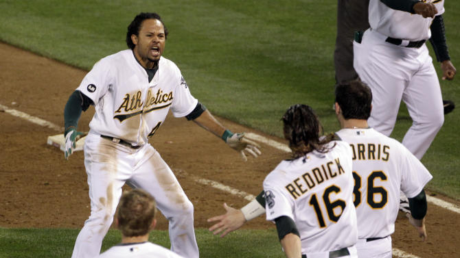 Oakland Athletics left fielder Coco Crisp (4) celebrates after he hit single to score Seth Smith and win the game 4-3 in the ninth inning of Game 4 of an American League division baseball series against the Detroit Tigers in Oakland, Calif., Wednesday, Oct. 10, 2012. (AP Photo/Eric Risberg)