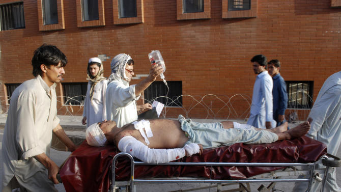 A Pakistani man who was injured in a bomb blast in a Mosque in Baz Darrah village in the Malakand district of Khyber Pakhtunkhwa province, is brought to a hospital in Peshawar, Pakistan, Friday, May 17, 2013. Bombs that exploded outside two mosques in a village in northwestern Pakistan killed several people Friday, underlining the challenge of militant violence facing a new government set to take power under the leadership of former Prime Minister Nawaz Sharif. (AP Photo/Mohammad Sajjad)