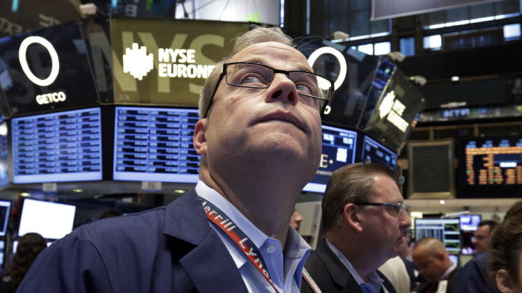 Trader David O''Day, left, works on the floor of the New York Stock Exchange, Friday, June 21, 2013. Global stock markets reeled Monday, June 24, 2013 with Shanghai's index enduring its biggest loss in four years, after China allowed commercial lending rates to soar in a move analysts said was aimed at curbing a booming underground lending industry. (AP Photo/Richard Drew)