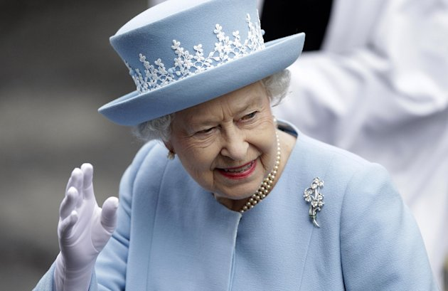 Britain's Queen Elizabeth II waves to the public as she arrives for a Service of Thanksgiving in Saint Macartin's Cathedral in Enniskillen, Northern Ireland, Tuesday, June 26, 2012.  The Queen and the