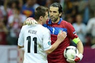 Italian goalkeeper Gianluigi Buffon and German forward Miroslav Klose hug after the Euro 2012 football championships semi-final match Germany vs Italy at the National Stadium in Warsaw. Buffon was left fuming as he went off the pitch despite Italy having qualified for the Euro 2012 final with a 2-1 win over Germany