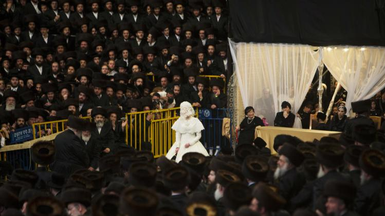 Ultra-Orthodox Jewish bride Penet dances with her relative during a wedding ceremony in Jerusalem