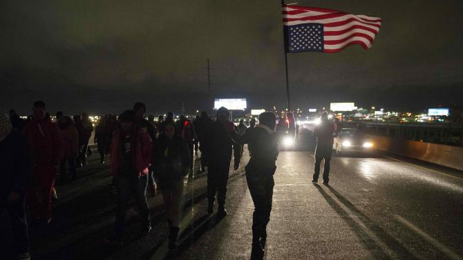 Protesters block Highway 170, after a man was fatally shot by a police man in Berkeley, Missouri