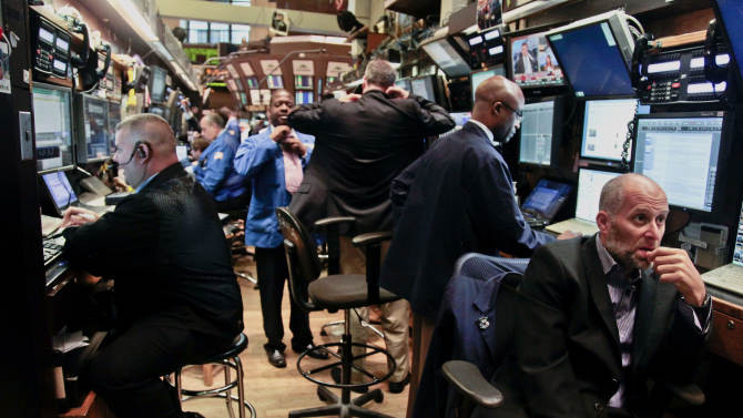 FILE- In this  Tuesday, July 10, 2012, file photo, traders prepare for the start of early trading at the New York Stock Exchange.  (AP Photo/Bebeto Matthews, File)