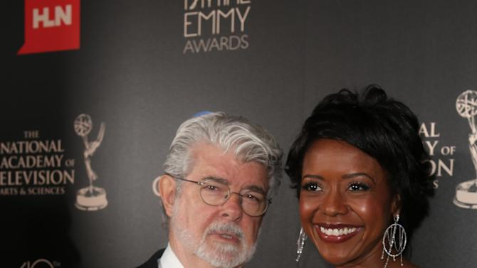 IMAGE DISTRIBUTED FOR EFG - George Lucas and Mellody Hobson seen at The 40th Annual Daytime Emmys Awards Redtouch Red Carpet, on Sunday, June 16, 2013 in Beverly Hills, Calif. (Photo by Ryan Miller/Invision for EFG/AP Images)