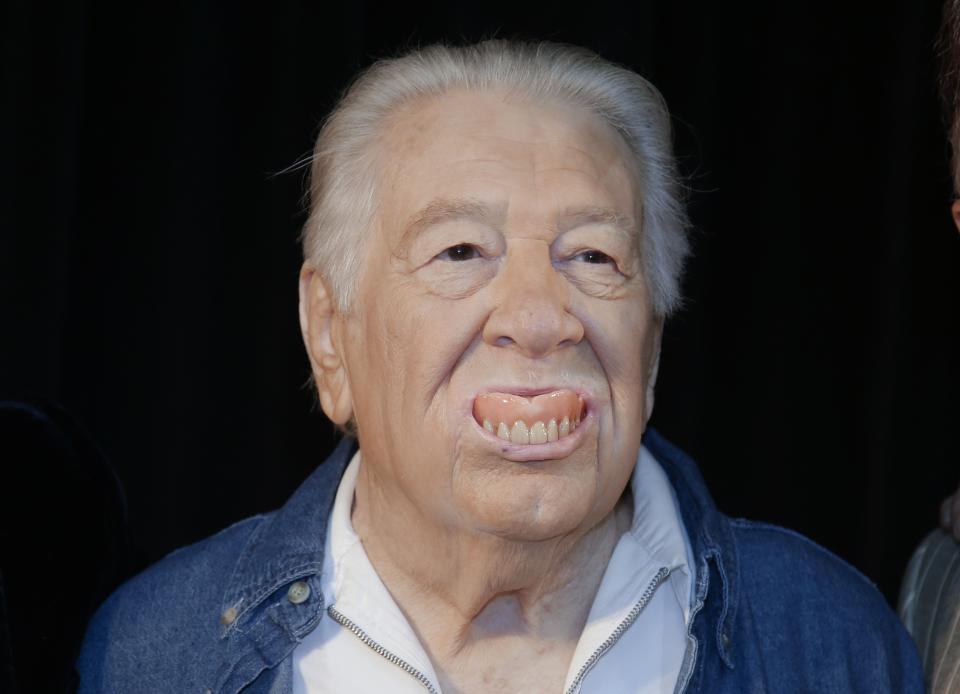 Jack Clement pops his false teeth out as he jokes with photographers on Wednesday, April 10, 2013, in Nashville, Tenn., after it was announced that he will be inducted into the Country Music Hall of Fame. Clement will be inducted along with Bobby Bare and Kenny Rogers. (AP Photo/Mark Humphrey)