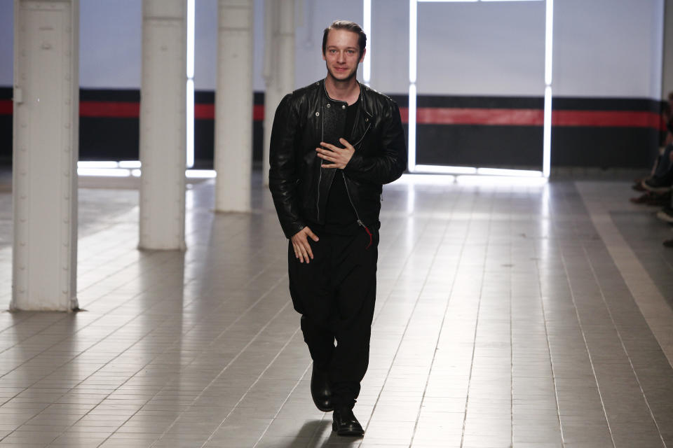 German fashion designer Damir Doma acknowledges applause at the end of his men's fashion Spring-Summer 2014 collection, presented Saturday, June 29, 2013 in Paris. (AP Photo/Thibault Camus)