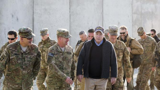 U.S. Senator John McCain arrives for a Christmas day visit on forward operating base Gamberi in the Laghman province of Afghanistan