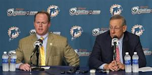 Miami Dolphins General Manager Jeff Ireland speaks next to the team's owner Stephen Ross during a news conference at the team's training facility in Davie, Florida