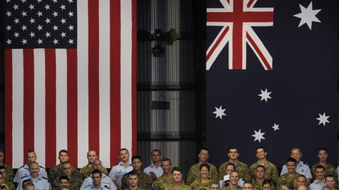 FILE - In this Nov. 17, 2011 file photo, President Barack Obama and Australian Prime Minister Julia Gillard arrive to speak with Australian troops during a visit to Royal Australian Air Force Base in Darwin, Australia. During a visit last year in which he received an overwhelmingly popular reception, Obama announced that up to 2,500 U.S. Marines will be stationed in Australia's north for joint training exercises. Australian government fears of a public backlash were never realized. (AP Photo/Susan Walsh, File)