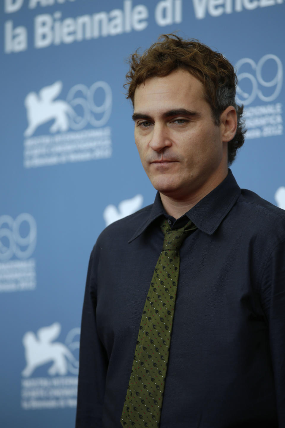 Actor Joaquin Phoenix poses for the photo call for the film 'The Master' at the 69th edition of the Venice Film Festival in Venice, Italy, Saturday, Sept. 1, 2012. (AP Photo/Andrew Medichini)