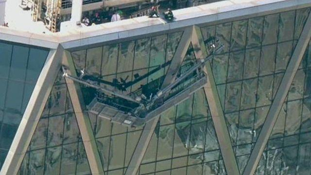 Window washers trapped on broken scaffold