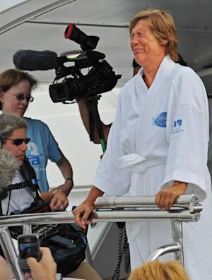 In this photo provided by the Florida Keys News Bureau, Diana Nyad, right, cries as she speaks to reporters and fans after arriving back in Key West, Fla., Tuesday, Aug. 9, 2011, following the 61-year-old marathon swimmer's failed attempt to swim from Cuba to the Florida Keys. (AP Photo/Florida Keys News Bureau, Rob O'Neal)