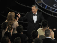 Ang Lee walks on stage to accept the award for best directing for &quot;Life of Pi&quot; during the Oscars at the Dolby Theatre on Sunday Feb. 24, 2013, in Los Angeles. (Photo by Chris Pizzello/Invision/AP)