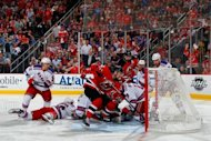 New Jersey Devils' Adam Henrique scores during overtime in game six of the NHL Eastern Conference final against the New York Rangers on May 25. Henrique's overtime goal lifted the Devils to a 3-2 victory over the Rangers and into the NHL Stanley Cup Final
