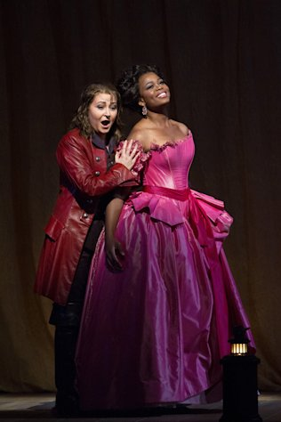 "In this Jan. 11, 2013 photo provided by the Metropolitan Opera, Karine Deshayes, left, performs as Isolier with Pretty Yende as Countess Adele during a dress rehearsal of Rossini's ""Le Comte Ory,"" at the Metropolitan Opera in New York. (AP Photo/Metropolitan Opera, Marty Sohl)"