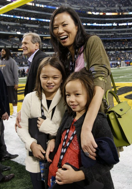 File photo showing Wendi stands on the field with her daughters before the NFL's Super Bowl XLV football game in Arlington