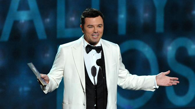 FILE - This Sept. 23, 2012 file photo shows Seth MacFarlane presenting an award at the 64th Primetime Emmy Awards at the Nokia Theatre in Los Angeles. Macfarlane will host the 85th Academy Awards on Sunday, Feb. 24, 2013 on the ABC Television Network. (Photo by John Shearer/Invision/AP, file)