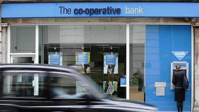 A taxi passes a branch of the Co-Operative Bank in central London