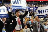 Congressional pages cheer following the tallying of votes during the roll call for nomination at the Republican National Convention in Tampa, Florida. Republicans crowned Mitt Romney the presidential nominee as his wife Ann sold their wholesome family and college sweetheart love story to US voters in a prime-time convention speech