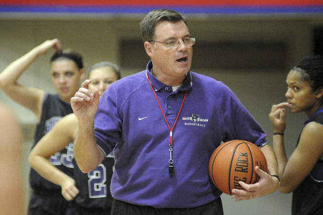 In this Nov. 4, 2010 photo, Holy Cross women's basketball coach Bill Gibbons outlines a play for his team during practice at the Hart Center in Worcester, Mass. Former Holy Cross player Ashley Cooper,